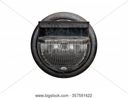 Headlight Of A Military Truck With Blackout Headlight Cover Isolated On White Background