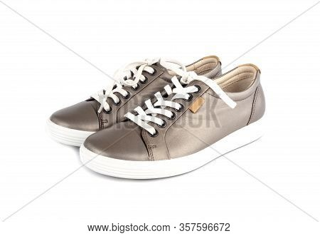 Shinny Brown Leather Sneakers With White Lace Isolated On White