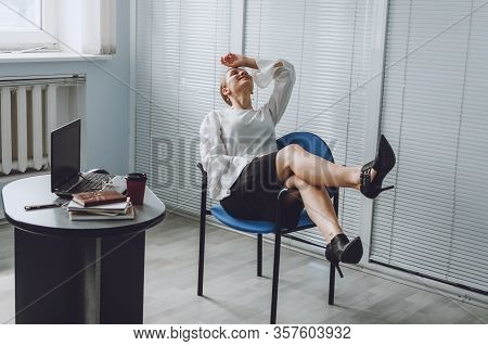 Young Business Woman Take It Easy Working And Resting In Office. Niksen, Do Nothing, Overwork, Life