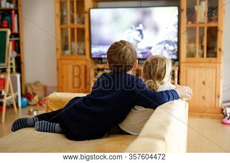 Cute Little Toddler Girl And School Kid Boy Watching Animal Movie Or Movie On Tv. Happy Healthy Chil