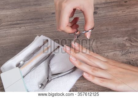 Do Yourself A Manicure. Trim The Nails On The Hand. Shorten Long Nails. Home Nail Care, Spa, Beauty.