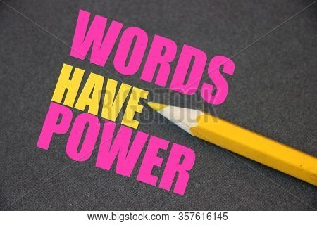 The Phrase Words Have Power Written With Yellow Pencil On Texturized Dark Grey Paper. Copywriting Pi