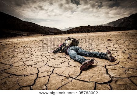 traveller lays on the dried ground