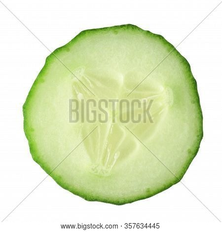 Sliced Slice Of Fresh Cucumber Closeup On A White Background. Top View. Isolated