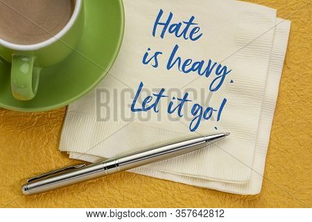 Hate Is Heavy. Let It Go! Inspirational Handwriting On A Napkin With Coffee. Stop Hating Concept.