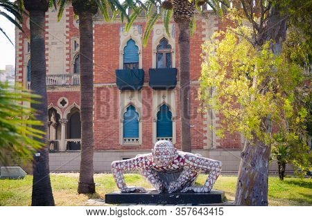 Italy, Reggio Di Calabria, May 11, 2018: Villa Genoese-zerbi, Palm Trees And Modern Art Sculptures O