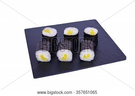 Traditional Fresh Japanese Sushi Maki On Black Stone Maki Daikon On A White Background. Roll Ingredi