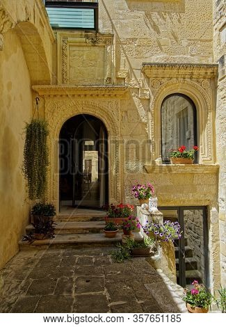 Lovely Italian Courtyards With Carved Portals, Flowers And Picturesque Stone Walls.