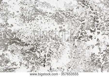 White Stucco Wall Texture. Crack Plaster Decorative Pattern. Abstract Shape Industrial Wall. Uneven