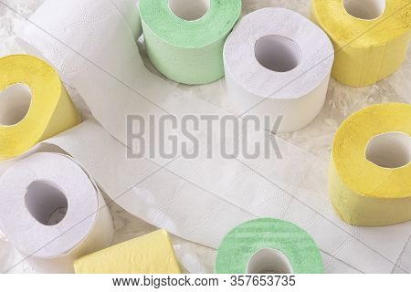 Set Of Colored Toilet Paper Rolls Of Toilet Paper , Top View, Copy Space. Concept Of Problem With Co