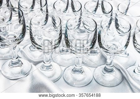Vodka Glass In Group. Catering Company Banquet Alcohol Table. White Table Cloth Vodka Shots. Restaur