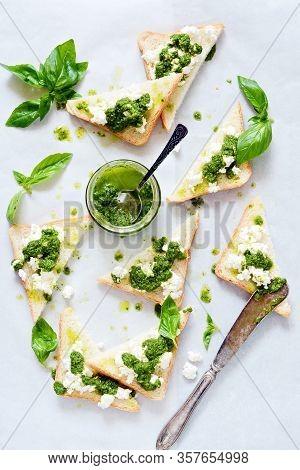 Crispy Toasts (crostini, Bruschetta) With Cottage Cheese (ricotta) And Freshly Prepared Pesto. Homem