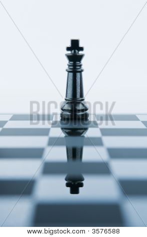 King chess piece reflected in the chess