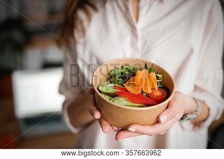 Woman Holds A Paper Plate With Food. Home Delivery Food. Healthy Eating Concept. When You Stay At Ho