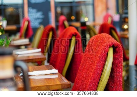 Wicker Chair Top Of View Closeup Photo. Wickerwork Chair With Red Pillow. Rustic Furniture Design. S