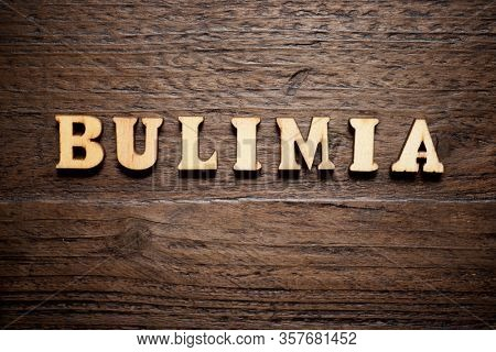 Bulimia word on a wood table.