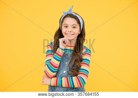 Optimistic Hipster Child. Small Girl Yellow Backdrop. Female Hairdresser. Happy Retro Kid Wear Color