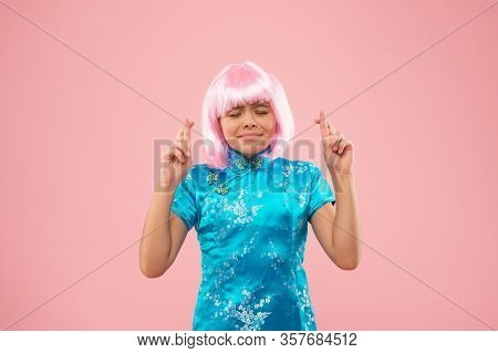 Hope And Expectation. Little Child Cross Fingers For Luck. Cute Child Make Wish Pink Background. Sma