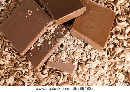 Chocolate And Chocolate Chips On A Wooden Table, Close-up Of Real Chocolate Made From Cocoa Beans An