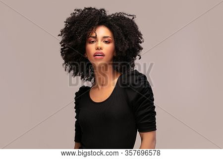 Beautiful Afro Woman Posing In Studio.