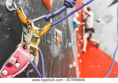 Close-up Detail Of Rock Climber Wearing Safety Harness And Climbing Equipment Outdoor. Climbing Cara