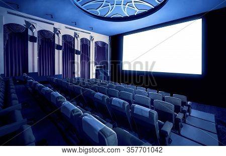 Cinema Theater Showing Empty White Movie Screen.