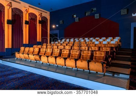 Large Cinema Theater With Empty Chair Movie Seats.