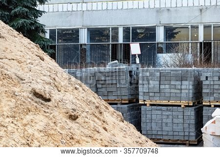 Pile Of Sand And Paving Slabs At Construction Site