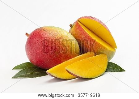 Mango Fruit With Mango Cubes. Juice Mango Slice, Summer Fruit Concept.