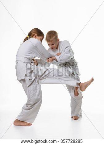 Two Judo Students Try To Hook Each Other Up