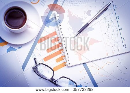 Financial Documents On Table With Financial Analysis Graphs. Business Papers With Analytical Data, N