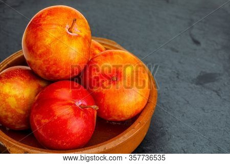 Yellow And Orange Plums (variety Known As Honey Or Mirabelle). In Clay Bowl And Space To Insert Your