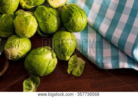 Raw, Fresh, Whole And Cut Brussels Sprouts (cabbages - Brassica Oleracea). Rustic And Homemade Appea