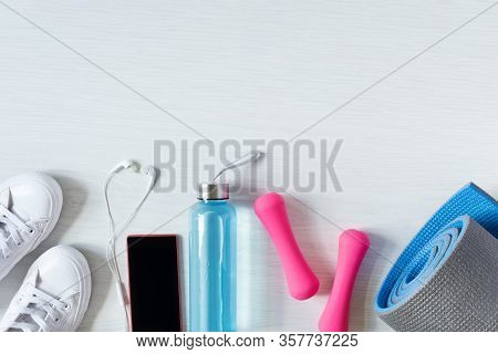 Fitness Equipment Top View With Copy Space. Fitness Concept. Dumbbells, Sneakers, Bottle Of Isotonic