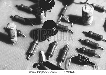 Old Electronic Board With Outdated Components. Black And White. The Concept Of Development Of The Ci