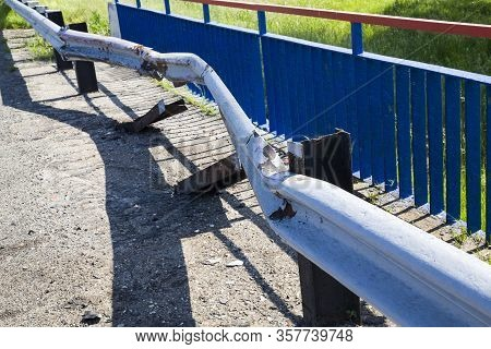 Old Metal Barrier Enclosing Part Of The Roadway And Provides Safety On The Road, Close-up, Barrier W