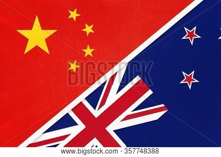 China Or Prc Vs New Zealand National Flag From Textile. Relationship Between Asian And Oceania Count