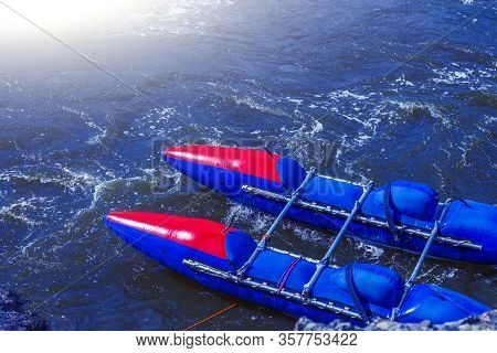 Catamaran Rafting On Water Rapids Of Mountain River. Catamaran Ready For Rafting, Moored On The Rive