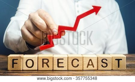 Man Holds Red Arrow Up Over Word Forecast. Budget Surplus, Optimistic Price Quotes, Rise Of Company