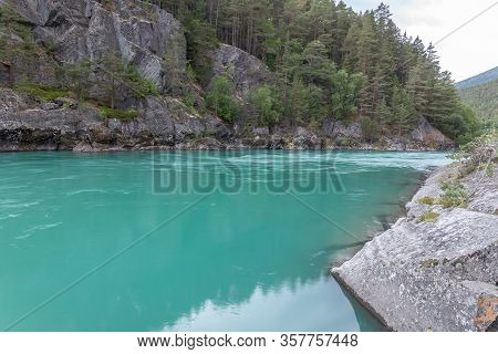 Nature Of Norway. Mountain River With Clear Water. Rocky Slope With A Picturesque Waterfall. Hiking