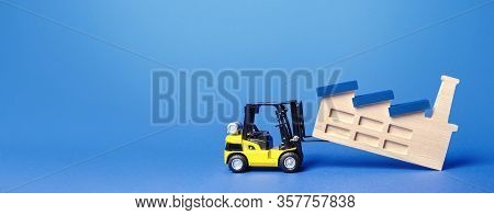 Forklift Truck Transports A Factory Plant To New Location. Revision Of Strategy For Allocation Of Pr