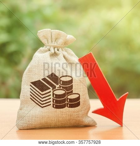 Money Bag Near A Red Arrow Down. Recession Of Economy. Economic Decline. Devaluation. Crisis And Eco