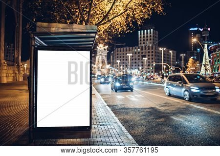 Night Shot Of A Luminous Advertising Lightbox Or Display At A Bus Stop In Barcelona, Spain