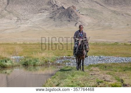 Altai, Mongolia - June 11, 2017: Horseback In The Mongolian Landscape. Altai, Mongolian Valley View