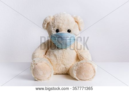 Cute Teddy Bear With Protective Medical Mask On His Face. Concept Of Of Illness, Hygiene And Virus P