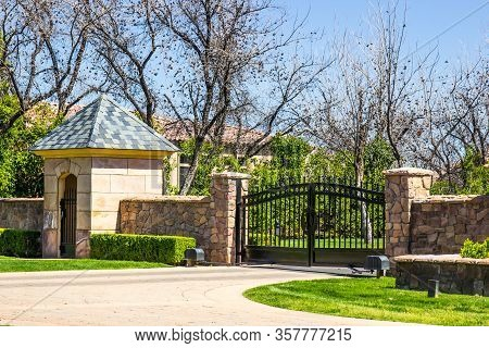 Electric Entry Gate, Gate House And Flagstone Wall
