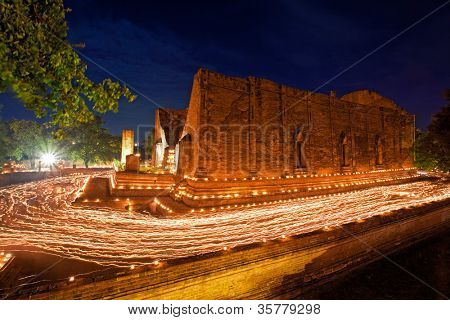 candle light trail of Buddhism Ceremony at temple ruin on Asalha Puja day