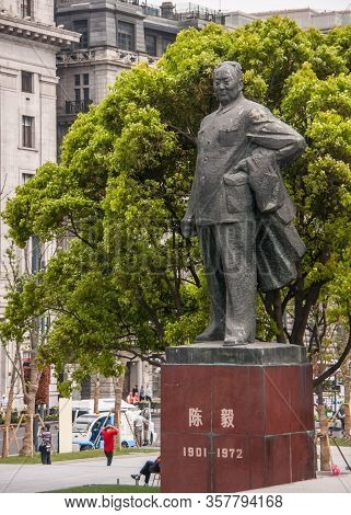 Shanghai, China - May 4, 2010: Massive Gray Statue On Red Pedestal Of Chen Yi, First Mayor, A Man, W
