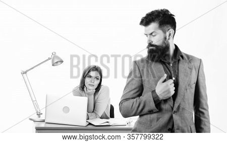 Ambitious Lady. Sexy Woman Boss And Male Employee Working Together. Pretty Woman Looking At Bearded