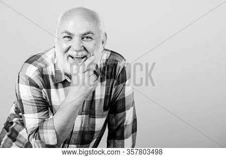 Mature Bearded Man In Checkered Shirt. Positive Emotions. Happy Old Grandad. Grandfather On Retireme